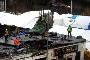 The wreckage of the police three-tonne Eurocopter is lifted from the Clutha bar in Glasgow following the crash which killed 10 people in 2013. Picture: PA