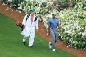 Tiger Woods walks with his caddie Joe LaCava on the 13th hole during a practice round at Augusta. Picture: Andrew Redington/Getty Images
