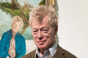 Sir Roger Scruton poses next to his portrait painted by artist Lantian D. Picture: Ian Gavan/Getty Images