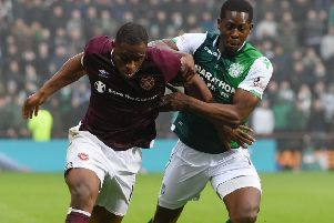 Hibernian's Marvin Bartley, right, with 'Hearts' Uche Ikpeazu. Picture: SNS