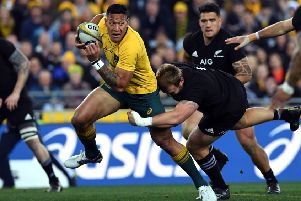 Australia full-back Israel Folau, left, is set to have his contract terminated over his latest anti-gay rant. Picture: William West/AFP/Getty Images