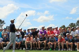 All eyes on Tiger Woods' tee shot at the eighth during the opening round at Augusta.