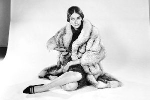 Tania Mallet modelling a fur coat in 1964. (Picture: Larry Ellis/Express/Getty Images)