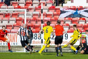Falkirk's Davis Keillor-Dunn fires past Dunfermline's Ryan Scully. Pic: SNS/Bruce White