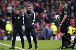 Aberdeen manager Derek McInnes exchanges words with referee Craig Thomson at full-time. Picture: SNS