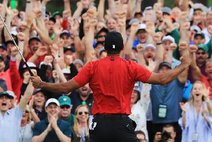 Tiger Woods of the United States celebrates after sinking his putt on the 18th green to win during the final round of the Masters at Augusta National Golf Club. (Photo by David Cannon/Getty Images)