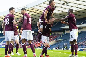 Celebration time for Hearts' Sean Clare, Steven MacLean, Olly Lee, Bobby Burns and Uche Ikpeazu. Picture: Alan Harvey/SNS