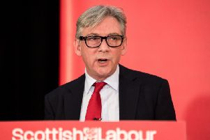 Scottish Labour leader Richard Leonard has said he would make the real living wage and trade union rights compulsory for the awarding of public contracts.