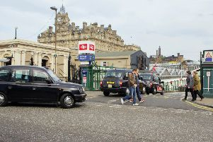 Taxis queue to go through a set of two barriers. Pic: Malcolm McCurrach