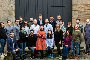 The Amiqus team at the firm's Leith HQ with chair Sir Sandy Crombie. Picture: Robert Ormerod