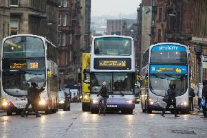 Operators complain they have to stump up 60 per cent of the cost of retrofitting bus engines. Picture: John Devlin