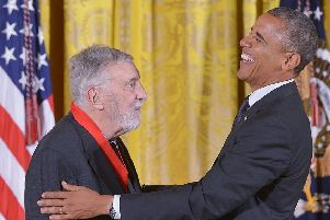 Barack Obama presents the  National Humanities Medal to David Brion Davis in 2014(Picture: MANDEL NGAN/AFP/Getty Images)