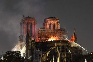 Flames and smoke are seen billowing from the roof at Notre-Dame Cathedral in Paris. Picture: Eric Feferburg/AFP/Getty Images