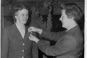 Elspeth Webster (right) handing over the badge of office to  Mrs Mary McGillivray, first president of the Deaconess Council
