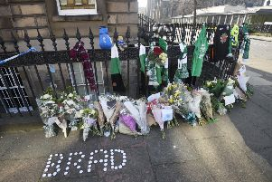 Floral tributes and Hibs scarves were left near the scene where Bradley Welsh was shot and killed last Wednesday evening on Chester Street. Picture: Greg Macvean