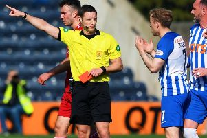 Referee Steven McLean brandishes his third red card of the afternoon, this time to Kilmarnock's Rory McKenzie. Picture: Gary Hutchison/SNS