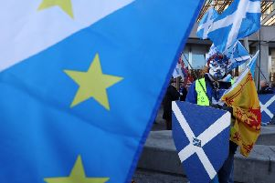 Scottish independence campaigners at a demonstration outside the Scottish Parliament in Edinburgh. Picture: Andrew Milligan/PA Wire