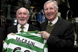 The late, great Billy McNeill pictured presenting Danny McGrain with a Celtic shirt to mark his 60th birthday in 2010. Picture: SNS
