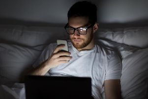 The blue light emitted from your devices will stop you from getting a good night's sleep (Photo: Shutterstock)