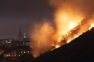 Firefighters battled through the night to extinguish a large gorse fire on Arthur's Seat in Edinburgh in February. Picture: SWNS