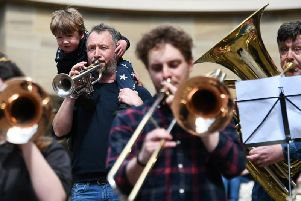 Musicians gathered to protest over councils's charging policies for musical instrument lessons.