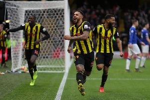 Andre Gray (centre) celebrates a goal for Watford. Picture: Getty Images