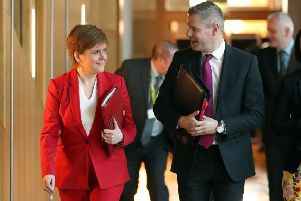 Nicola Sturgeon and Derek Mackay at the Scottish Parliament. Picture: Jane Barlow/PA