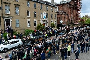 Celtic fans line the street as Billy McNeill's coffin passes