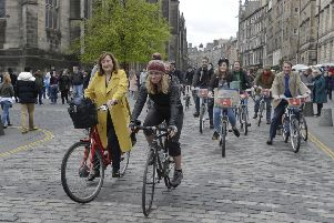 Lesley Macinnes, City of Edinburgh Councils's transport and environment convener,left, joined by a crowd of cyclists who rode from the City Chambers  to the Canongate. Picture: Neil Hanna/TSPL