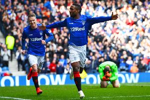 Jermain Defoe celebrates after scoring to give Rangers a 1-0 lead over Hibernian. Picture: SNS.
