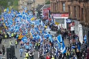 Scottish independence supporters march through Glasgow during the All Under One Banner march on Saturday