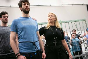 Students from the Royal Conservatoire of Scotland in rehearsal for the UK staged premiere of Dead Man Walking. From left: Rhys Thomas who plays a prison guard; Mark Nathan who plays death row prisoner Joseph De Rocher; Pedro Ometto who plays a prison guard and Carolyn Holt who plays Sister Helen Prejean. PIC: Royal Conservatoire of Scotland/Robbie McFadzean.