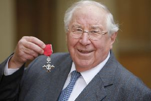 Antiques Roadshow expert Henry Sandon pictured receiving his OBE. Picture: SWNS