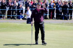 Bob Macintyre acknowledges the crowd after his birdie at the 18th. Picture: PA.