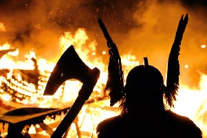 The Guizer Jarl or Chief of the Jarl viking squad is silhoutted by a burning viking longship during the annual Up Helly Aa Festival, Lerwick, Shetland Islands. Picture: CARL DE SOUZA/AFP/Getty Images