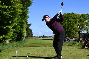 Bob Macintyre of Scotland tees off on the sixth hole at the British Masters.