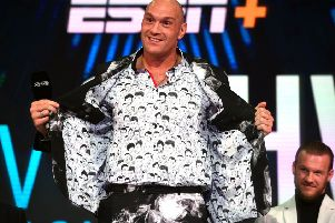 Tyson Fury shows off his shirt featuring drawings of former world heavyweight champions. Picture: Kirsty O'Connor/PA Wire