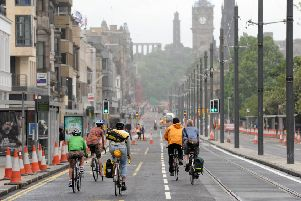 Cyclists are pictured here on Princes street during the tram works. 'Pic Ian Rutherford