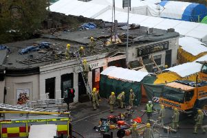 The wreckage of the police three-tonne Eurocopter before being lifted from the Clutha Vaults in Glasgow following the crash which killed at least nine people.