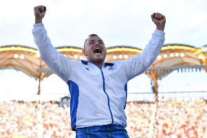 Mark Dry celebrates winning bornze in the men's hammer throw final at the 2018 Gold Coast Commonwealth Games. Picture: AFP/Getty Images