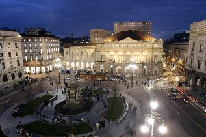 Milan is home to some echoingly grand architecture (Picture: Luca Bruno/AP)