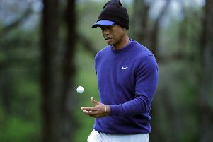 Tiger Woods flips his ball as he walks along the ninth green during a practice round for the US PGA Championship. Picture: Julie Jacobson/AP