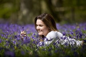 A young woman laying in a field of bluebells. Pic: File