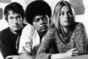 Promotional studio portrait of actors Michael Cole (L), Clarence Williams III and Peggy Lipton for the television series, 'The Mod Squad,' c. 1968. (Photo by ABC/Hulton Archive/Courtesy of Getty Images)