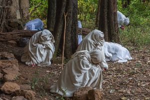 Kieran Dodds' picture for the Ambit exhibition at Stills shows worshippers dressed in their Sunday robes in Zhara church forest, Ethiopia