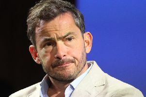 Editor John Witherow admitted that, in a satirical column by Giles Coren (pictured), a gag about people who were 'something in between' men and women, should have been cut. Picture: PA