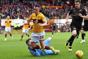 Motherwell's David Turnbull is brought down by Livingston goalkeeper Ross Stewart and a penalty is awarded. Picture: SNS