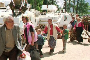 Bosnian Muslim refugees from Srebrenica seek refuge at a UN base in Potocari in July 1995 (Picture: AP)