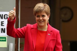 First Minister Nicola Sturgeon attends a polling place for the EU elections