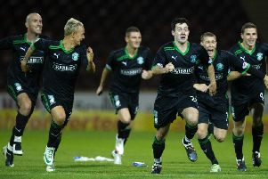 Richie Towell, centre, celebrates a penalty shoot-out win against Motherwell with Sean O'Hanlon (far left), Leigh Griffiths, Martin Scott, David Wotherspoon and Paul Hanlon